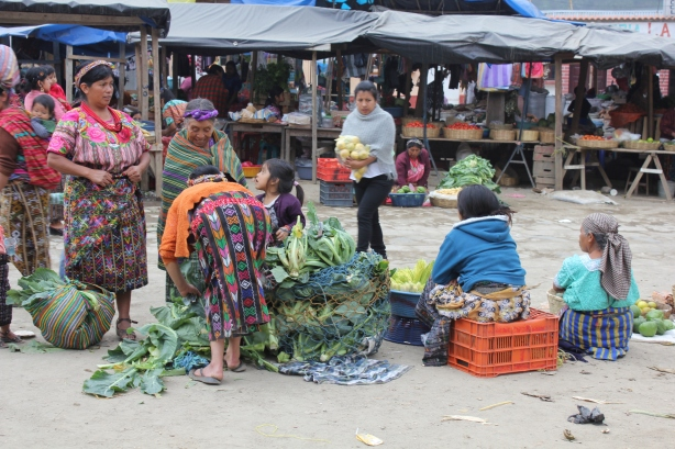 Market in Guatemala: note the young girl in the center forming part of the sales-team