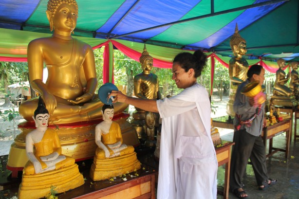 the cleaning of the Buddha